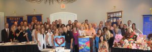 Members of the Cross Timbers Rotary Club celebrate their first anniversary.