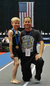 Micah Terrill and Win Kids coach Jack Lee.