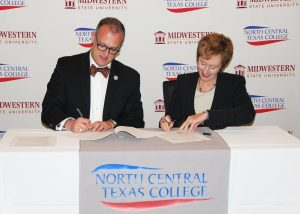 MSU President Dr. Shipley and NCTC President Dr. Wallace signing the contracts.