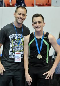 Win Kids coach Jack Lee and trampoline champ Quinn Maguire.