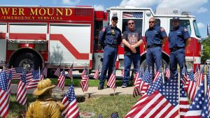 Eric Curtis (2nd from left) with Chance Nelms, Daniel Pierce, Martin Patino from the Flower Mound Fire Department.