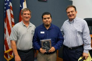 At Monday's Town Council meeting, Mayor Tom Hayden, alongside Environmental Health Manager Tom Vyles (left), presented a representative from Autumn Leaves with their Food Safety Excellence Award. (Photo courtesy: Town of Flower Mound)