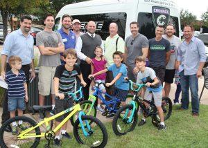 Lantana dads give back: Brett Moody, Kris Bryan, John Blaskovich, Jimmy Bridges, Rob Boles, Jason Shewmaker, Bob Schmalholz with Cadance Cyclery, Ryan Williams, Justin Snyder.
