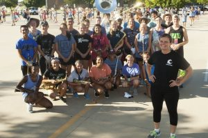 Amy Woody oversees 175 budding musicians as Guyer High School's Band Director. (Photo by Helen's Photography)