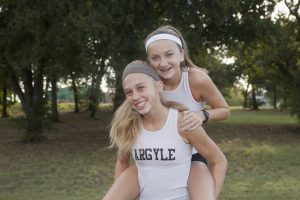 Lanie Rodgers and Rhyle McKinney are making tracks at Argyle High School this year in the sport of distance running. (Photo by Helen's Photography)