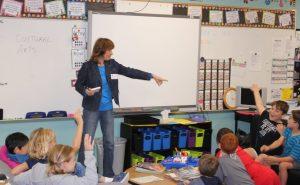 Annette Weir talking to third graders in Allison Smith's class on Career Day at Garden Ridge Elementary School in Flower Mound.