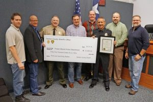 Sheriff Will Travis (second from left) and Flower Mound Police Chief Andy Kancel (third from right) with Flower Mound Town Council members.