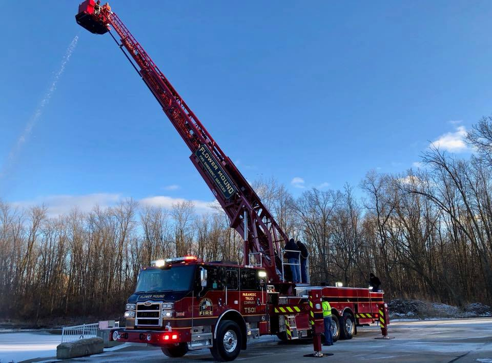 Flower Mound Fire Department officials inspect the department's new Truck 501 in Appleton, Wisconsin.