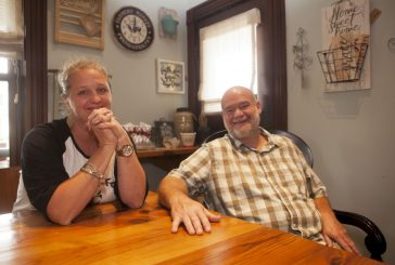 Farmhouse family planting roots in community