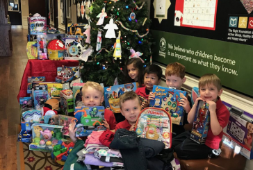 Local Primrose Schools deliver large donation to CCA's gift drive