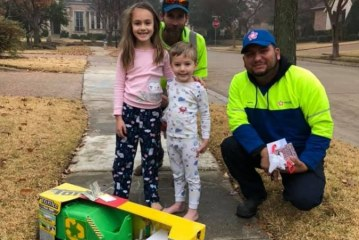 Local garbage collectors deliver Christmas gift to their biggest fan