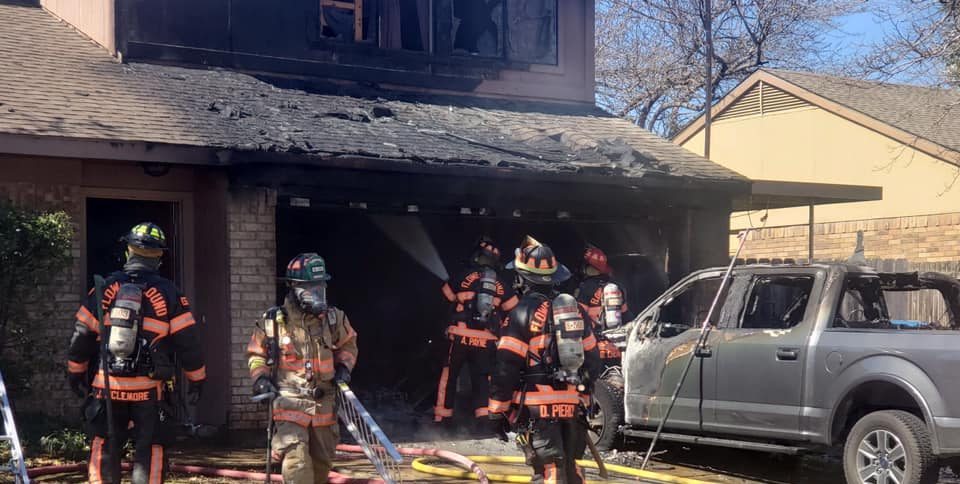 Firefighters douse a vehicle-and-house fire, courtesy of the Flower Mound Fire Department.