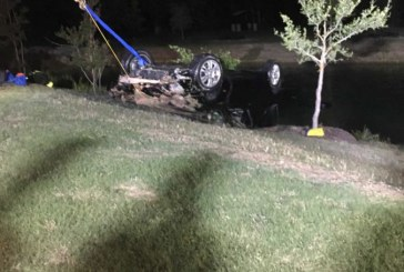 Car drives into the water near Flower Mound River Walk