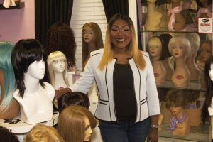 Ty Sanford of Flower Mound founded Tresses of Care to improve the lives of children battling illness by providing them with wigs. (Photo by Helen's Photography)