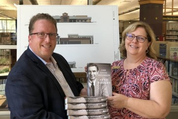 Local real estate broker promotes being a 'Good Neighbor' with library donation
