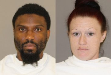 2 arrested by Double Oak police; man with warrant tried to run