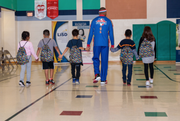 Local business, Globetrotters host assembly at Flower Mound elementary school