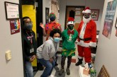 Local business, volunteers deliver Christmas gifts to LISD students